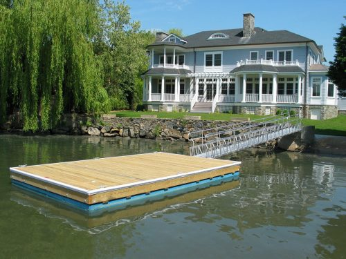 Marine gangway to access floating dock